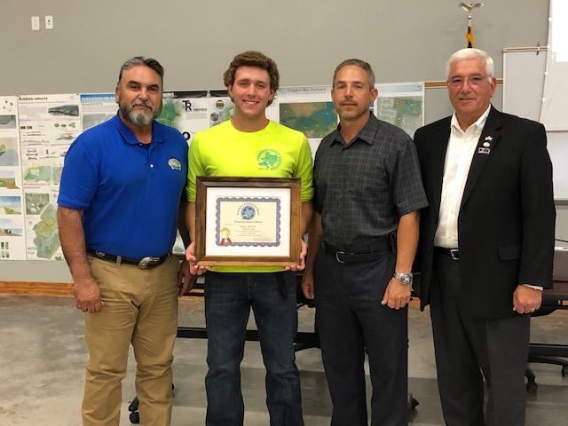 Kyle Skinner was reecognized at a recent City Council meeting for saving the life of a pool patron.  He is pictured with Mayor Rios (r), Pool Manager Joe Reikers and Parks Director Rick Martinez.